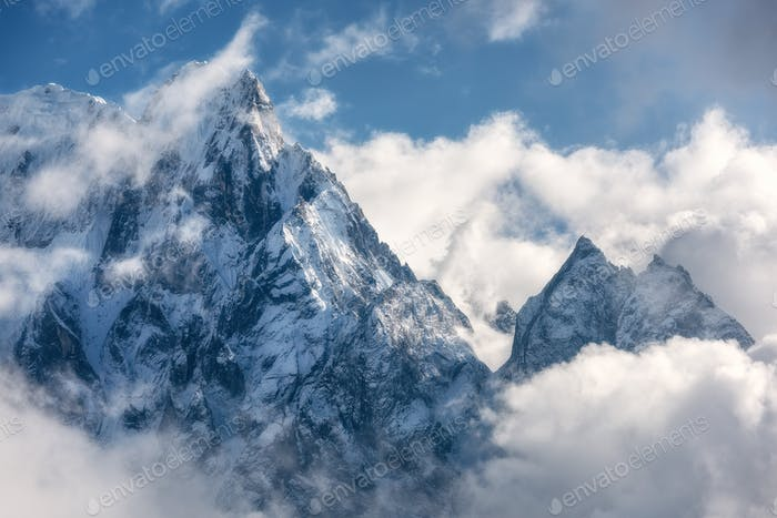 Mountains with snowy peaks in clouds in Nepal