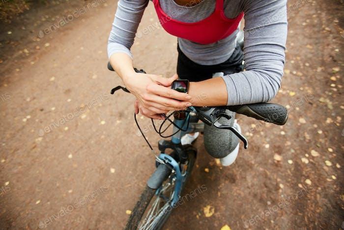 Cyclist with smartwatch