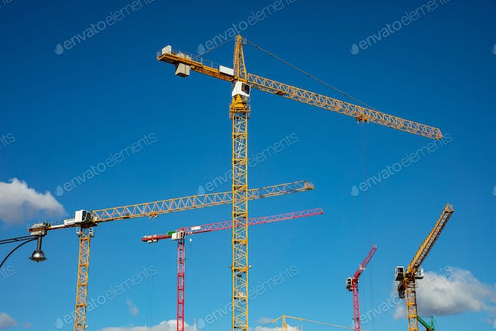 Construction site.Tower cranes on blue sky background