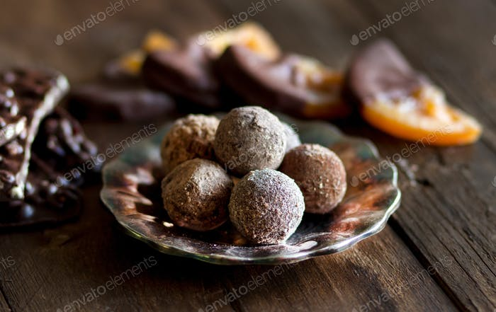 Chocolate, truffles and orange slices in dark chocolat