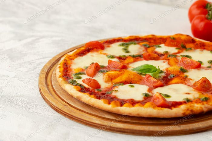 Freshly baked pizza on table close up