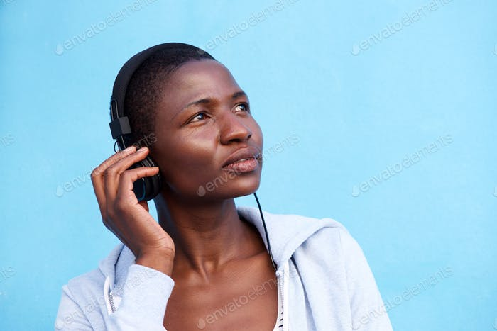 black woman listening to music with headphones