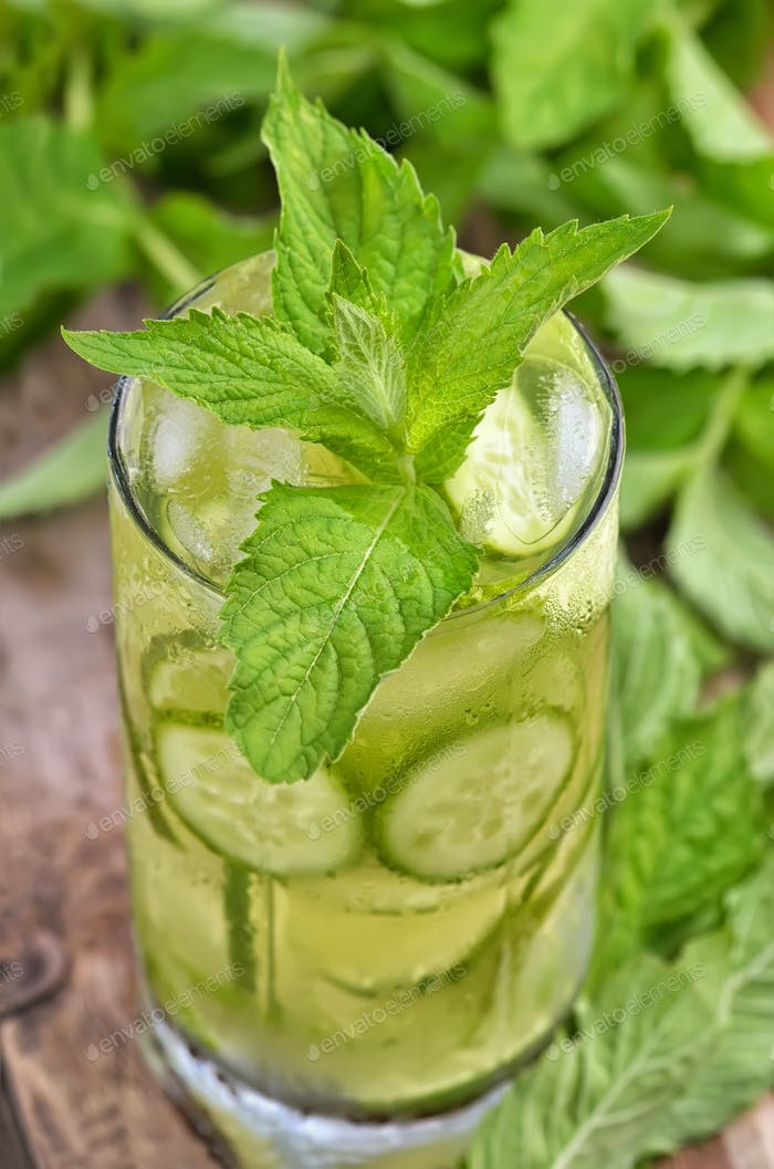 Lemonade with fresh cucumber, lime and mint in glass