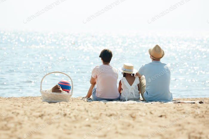 Pensive Family Looking at Sea