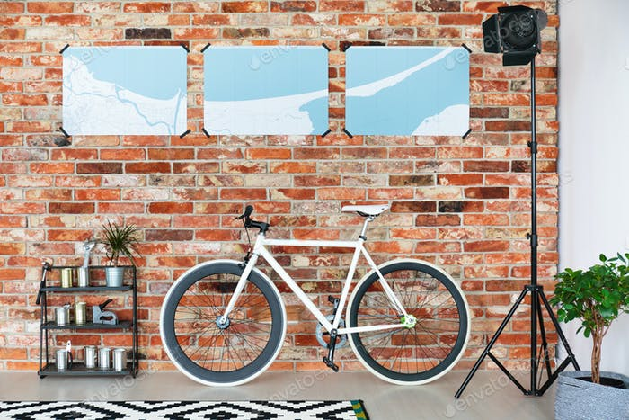 Bike standing against brick wall