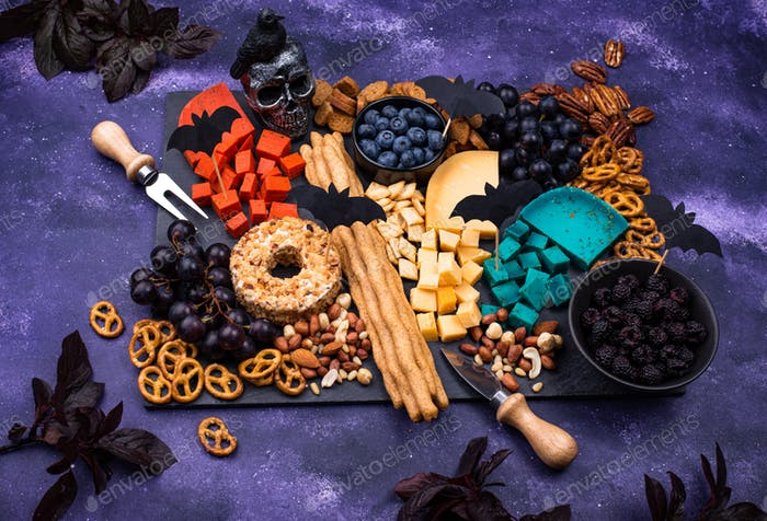Cheese plate with berries, nuts and snacks