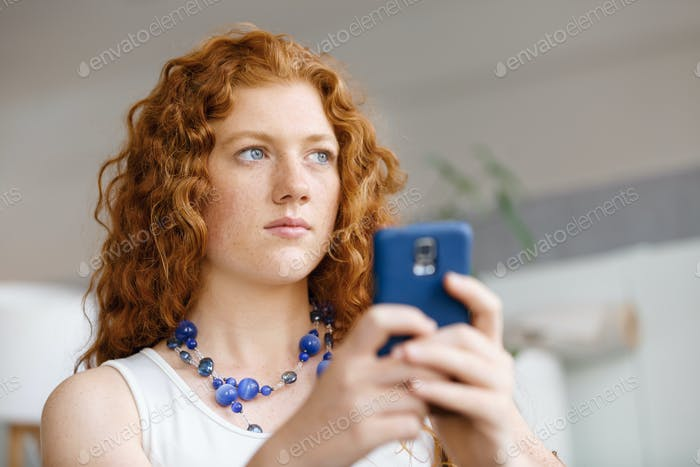 Happy beautiful young businesswoman using smart phone smiling