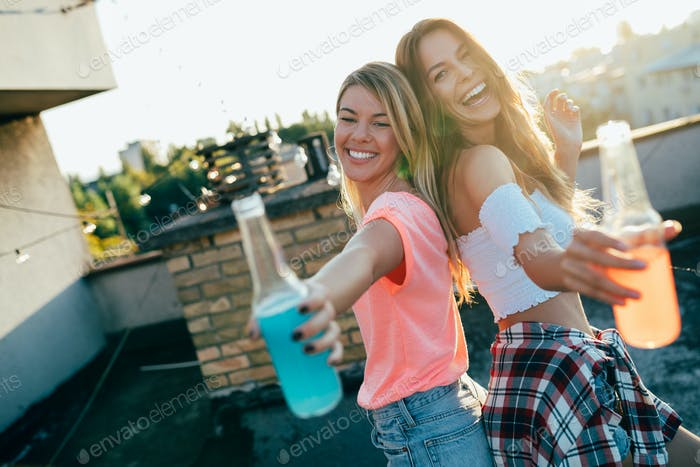 Happy young girls having fun at party