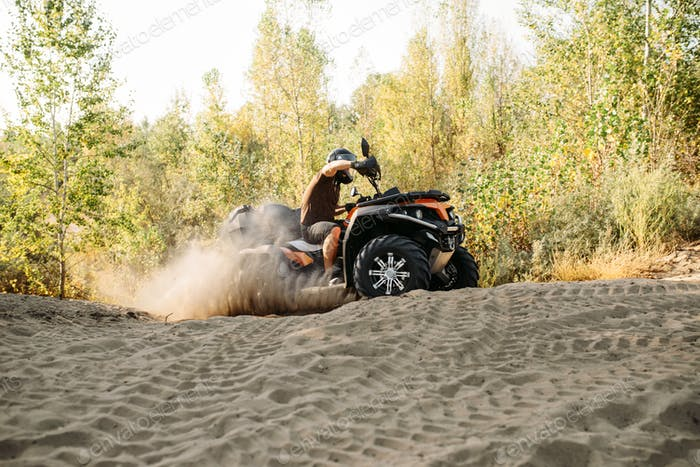 Atv freeriding in sand quarry, extreme sport