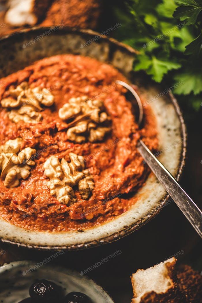 Turkish red pepper paste with walnuts, simit bagels and parsley