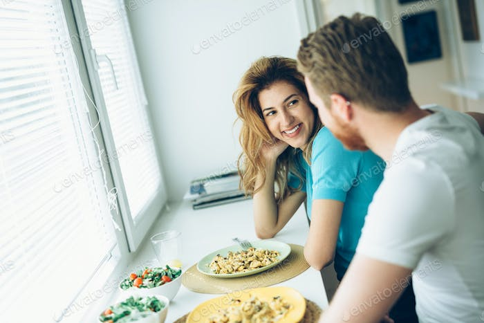 Couple having breakfast in the morning and smiling