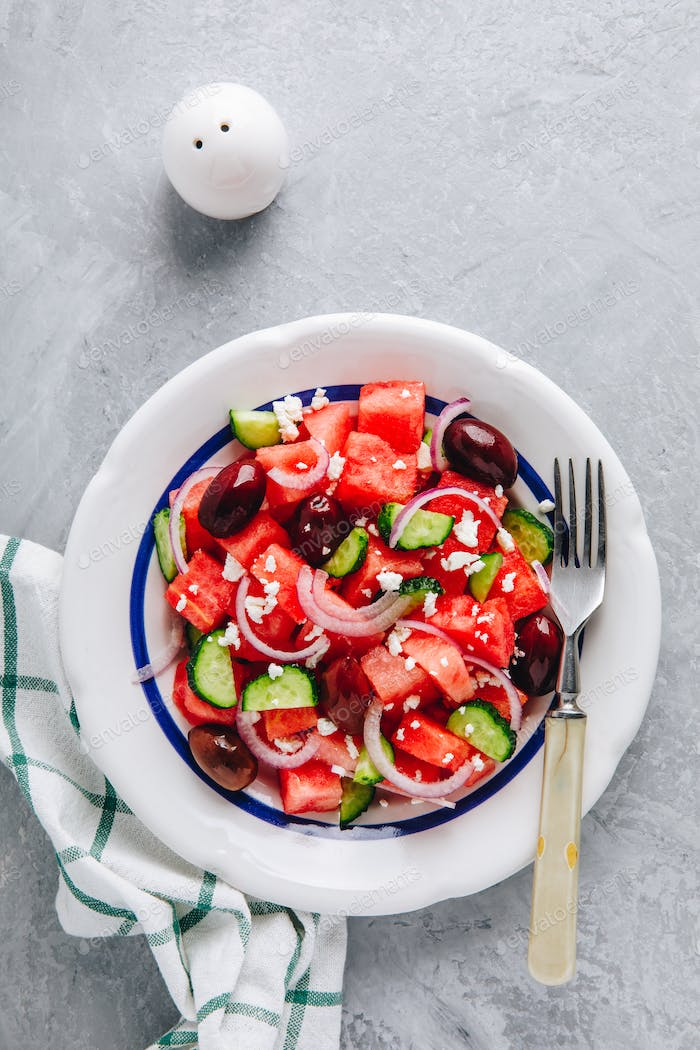 Fresh summer watermelon salad with feta cheese, cucumbers, olives and red onions