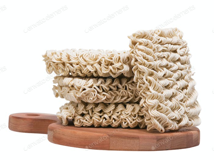 Ramen instant raw noodles on wooden plank 3/4 general view