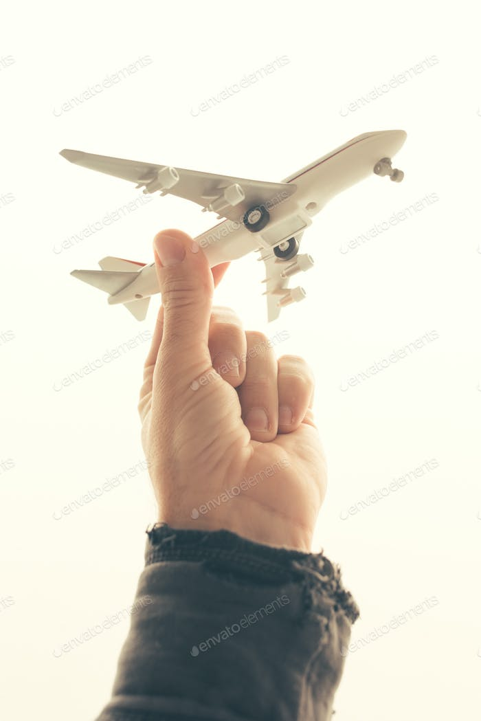 Man holding toy airplane