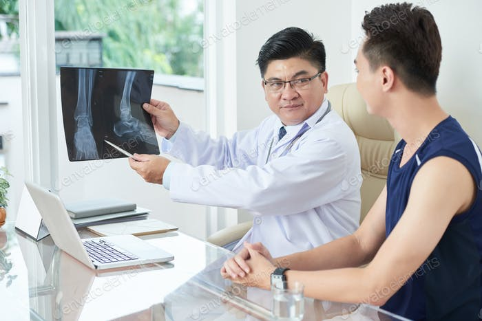 Doctor showing X-ray picture to patient