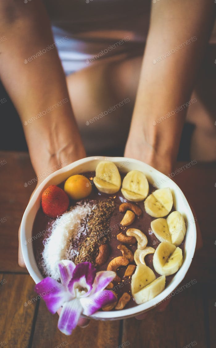 Vegan acai bowl breakfast closeup.