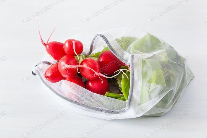 radish vegetable in reusable mesh nylon bag, plastic free zero w