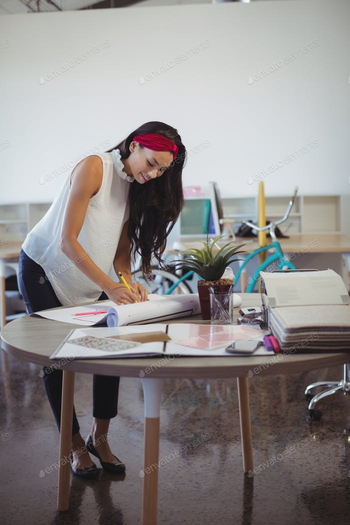 Young entrepreneur working at office desk