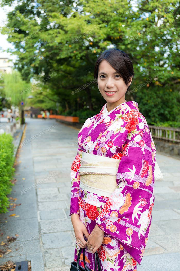 Woman with japanese traditional clothing at street