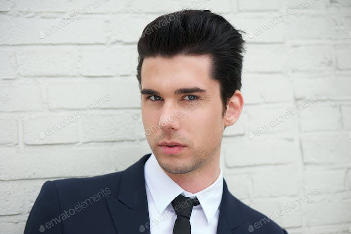 Close up portrait of a handsome young businessman outdoors