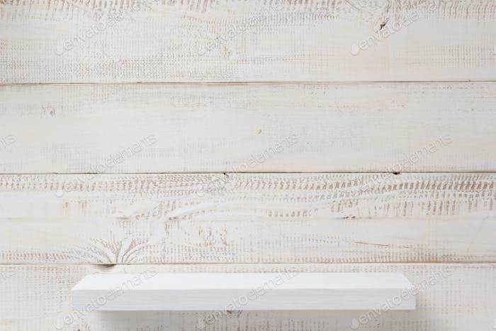 shelf at white plank wooden background