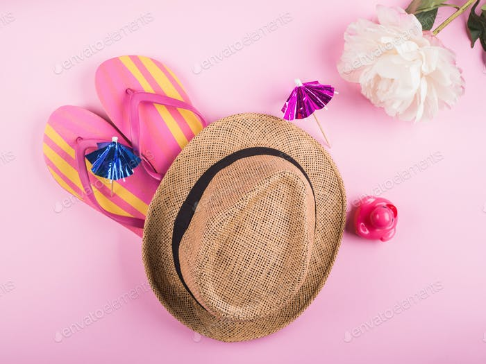 Summer beach vacation concept on pink