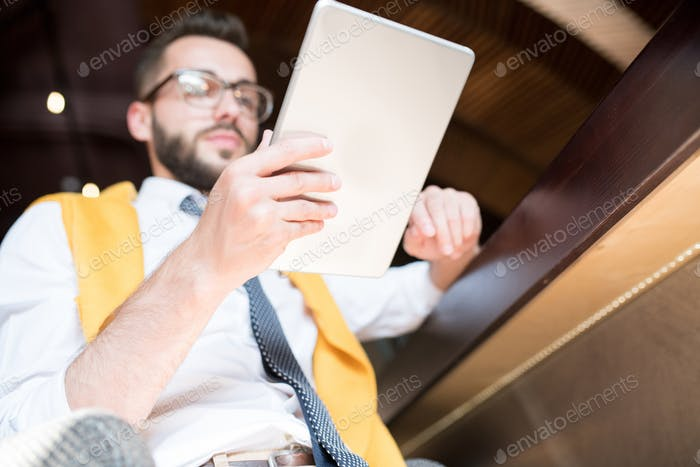 Businessman Using Tablet Low Angle