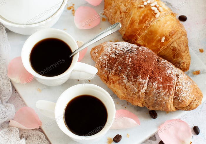 Breakfast with coffee and croissant