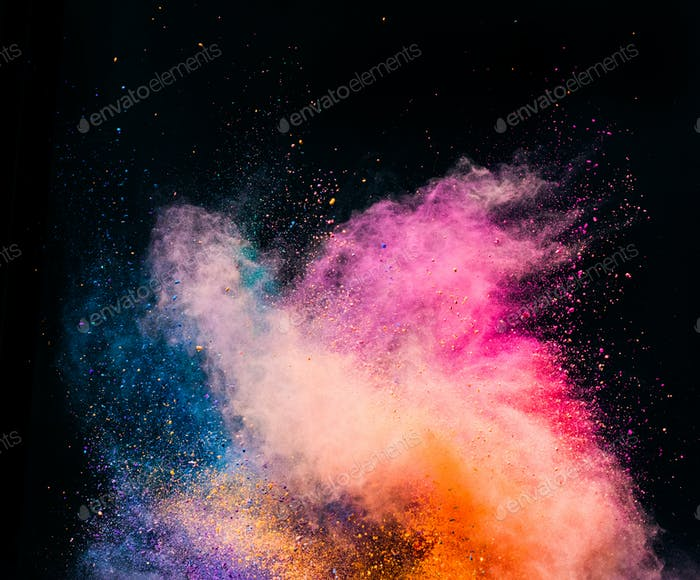 Colorful holi powder blowing up on black background.