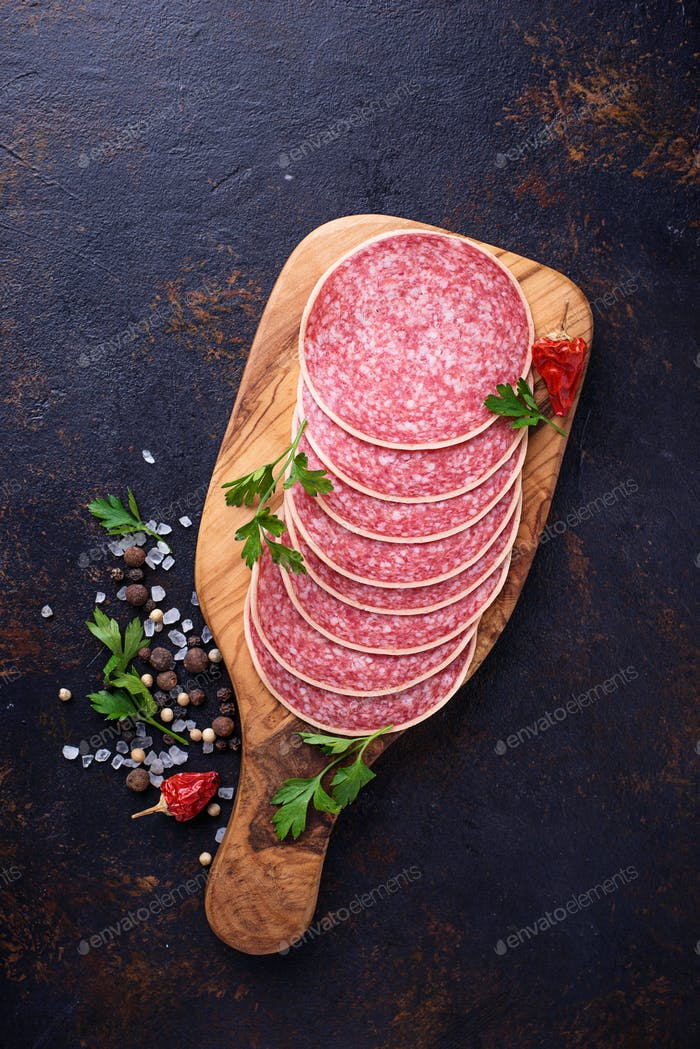 Italian salami sausage on wooden board.