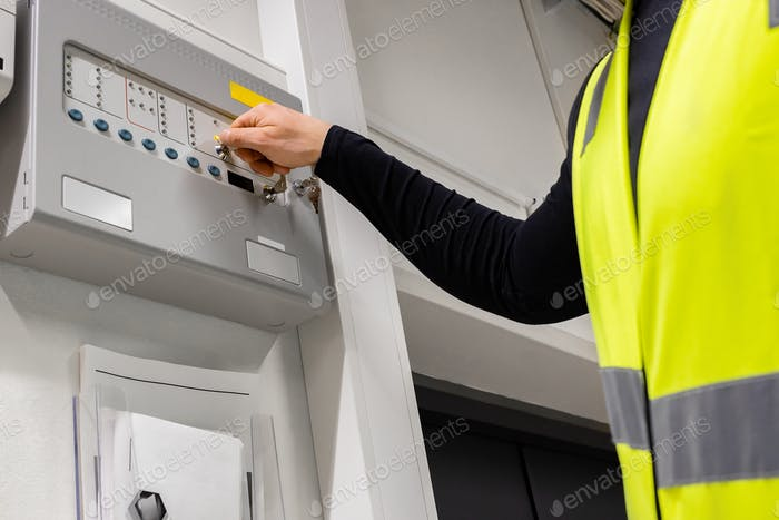 Thumbnail for Electrician Opening Fire Panel In Server Room