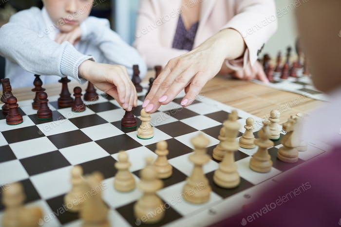 Teacher showing chess combination