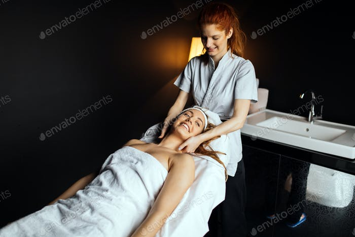 Masseur giving treatment