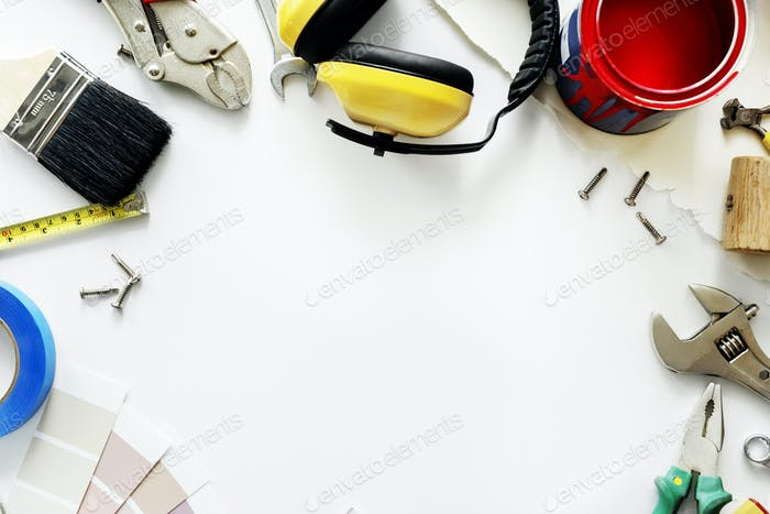 Flat lay of various technician tools isolated on white background