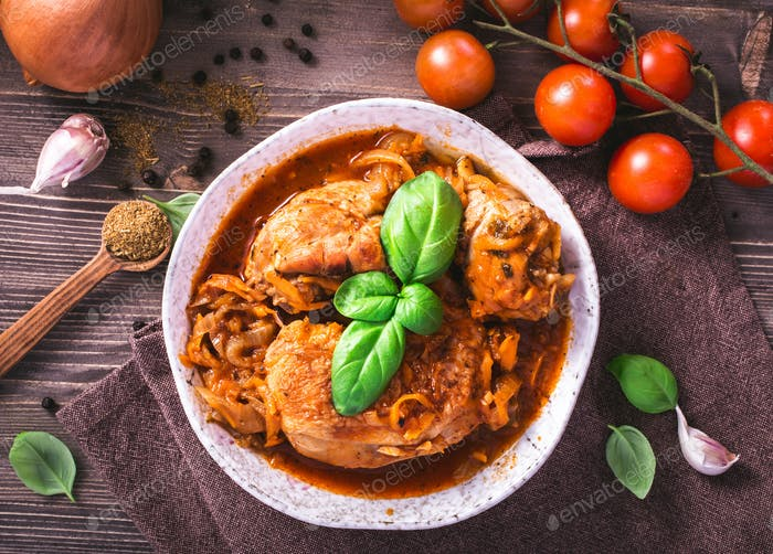 Chicken stewed with tomatoes top view