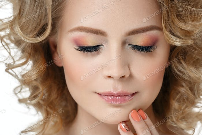 Colorful make up shadows and nails woman studio beauty portrait isolated on white