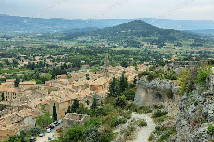 View of church houses and surrounding fields in St Saturnin les Apt, France