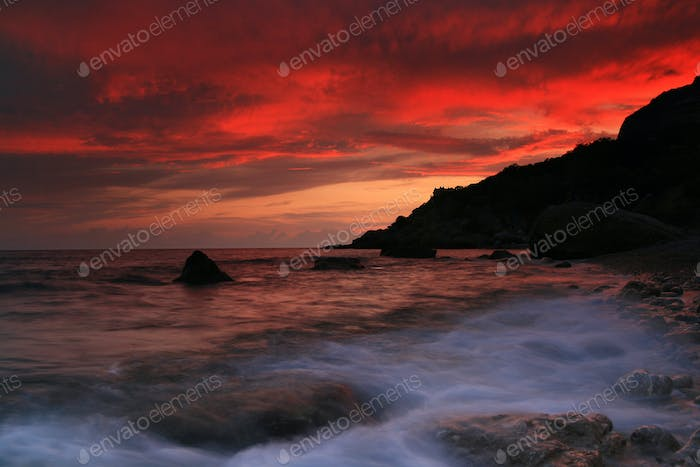 Thumbnail for Sunset on the rocky shore of tropical sea