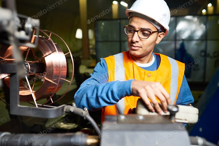 Machine Operator Wrapped up in Work