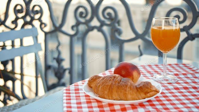 Breakfast on a balcony in Paris