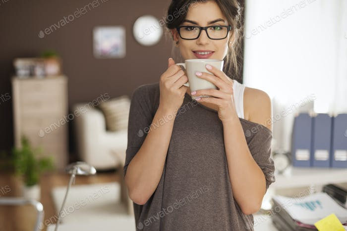 Portrait of beautiful woman with cup of coffee