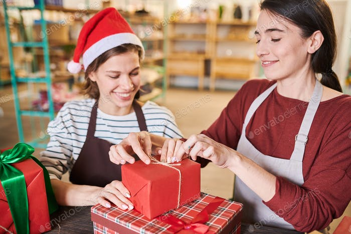 Young Women Wrapping Christmas Presents