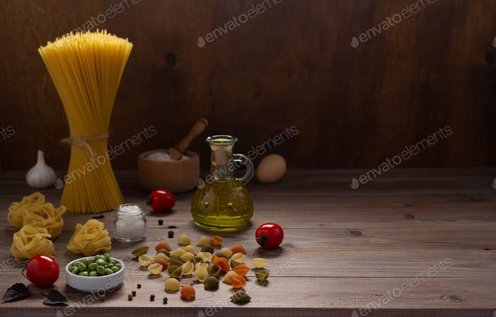 Pasta and food ingredient on wooden table background. Raw pasta italian food