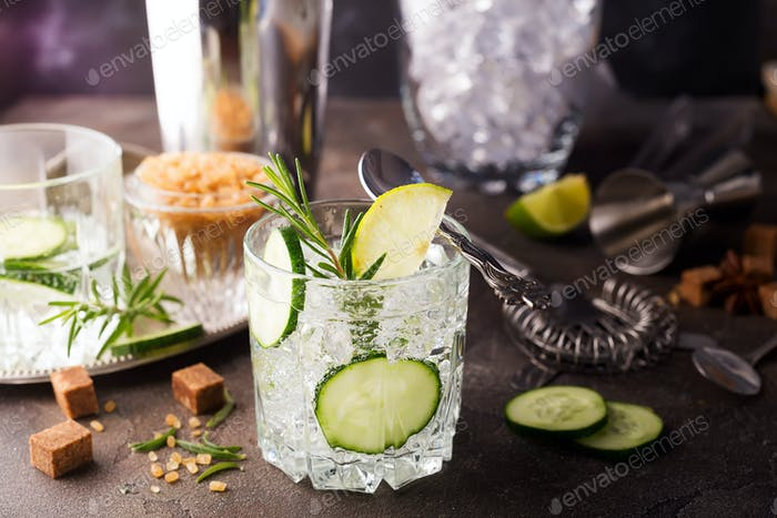 Homemade lime lemonade with cucumber, rosemary and ice