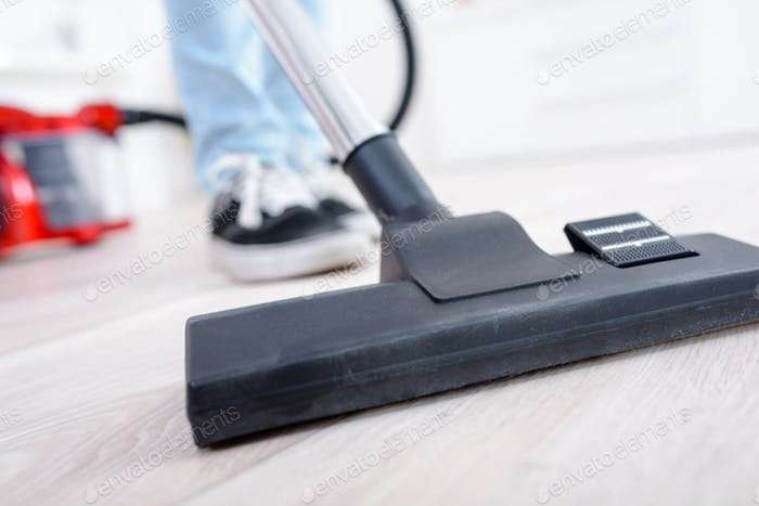 Closeup of vacuum on hard flooring