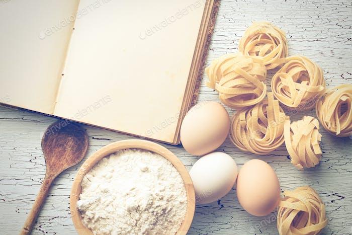 tagliatelle pasta with cookbook