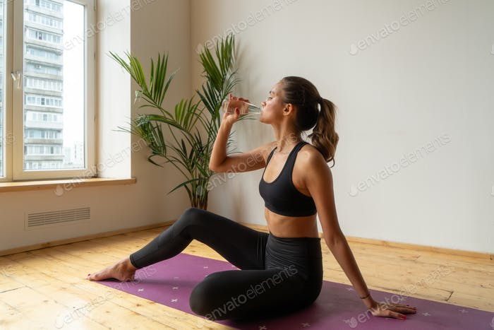 athletic female drinking water