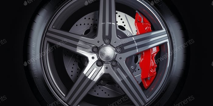 Car wheel with red breaks on black background.