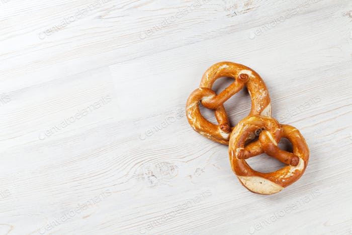 Pretzel. Beer snacks on wooden table