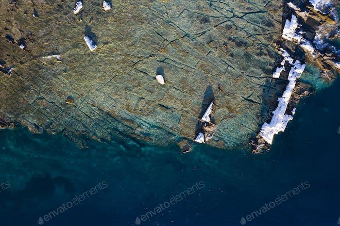 Aegean seashore and marble rocks in Aliki, Thassos island, Greece